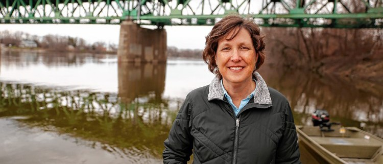 Kim Lutz, director of the Connecticut River Program with the Nature Conservancy, poses for a portrait Saturday along the river at the Elwell Recreation Area boat dock in Northampton. Photo: Dan Little/Daily Hampshire Gazette